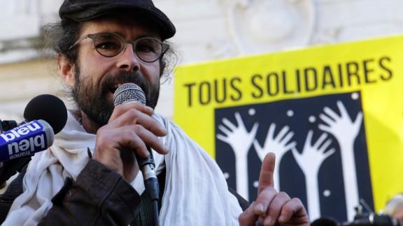 Activist farmer Cedric Herrou speaks outside the Nice courthouse on Wednesday.