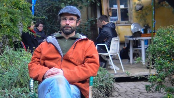 Olive and poultry farmer Cedric Herrou hosted migrants in caravans and tents on his property.