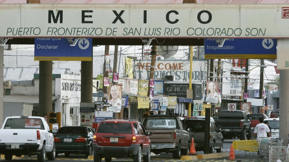 Cars head to Mexico from the border crossing at San Luis, Arizona, in June 2006.