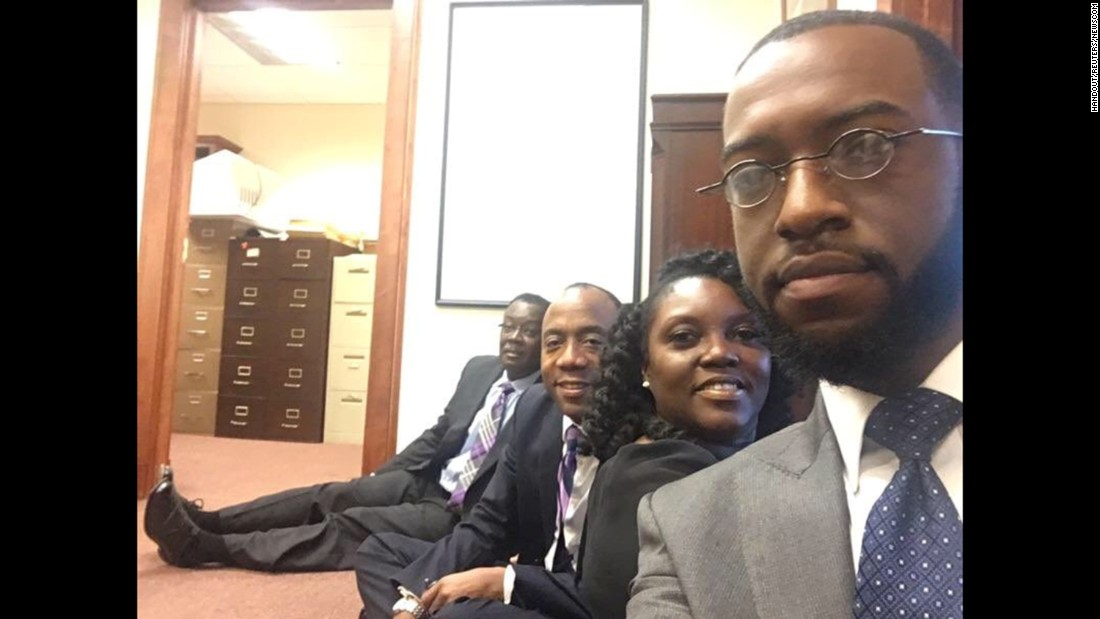 "Members of the NAACP occupy the office of Sen. <a href=""http://www.cnn.com/2016/11/18/politics/jeff-sessions-racism-allegations/"" target=""_blank"">Jeff Sessions</a>, US President-elect Donald Trump's pick for for attorney general, in Mobile, Alabama, on Tuesday, January 3."
