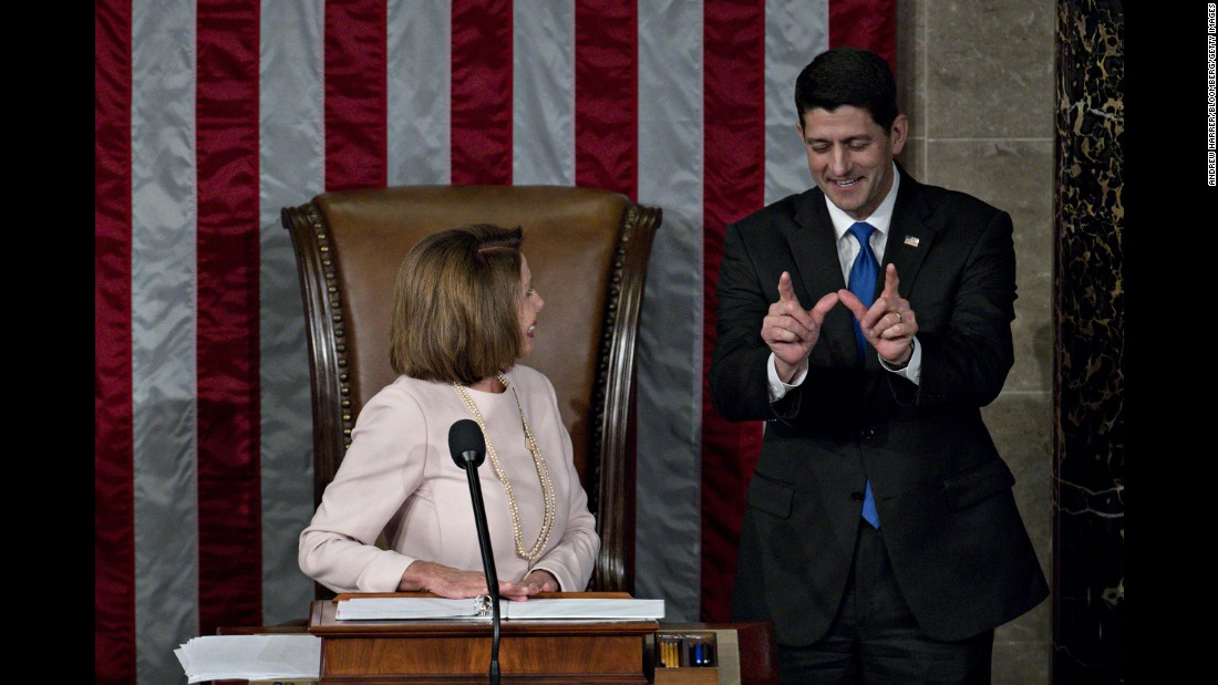 US House Speaker Paul Ryan talks with House Minority Leader Nancy Pelosi at the start of the 115th Congress on Tuesday, January 3.
