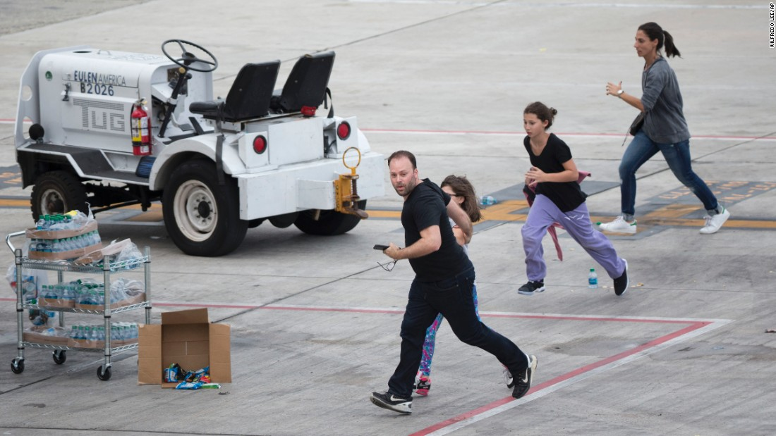 Fort Lauderdale airport: 5 dead, shooting suspect had gun in bag - on stretch ez go cart, airport gate sign, airport electric transport cart, airport food cart, airport baggage claim, airport surveillance radar, flight attendant cart, airport shuttle in carts, senior citizen airport cart, airport ground equipment, airport window, airport fire stations, airport traffic pattern, porter airport cart, airport fire trucks, airport moving walkway,