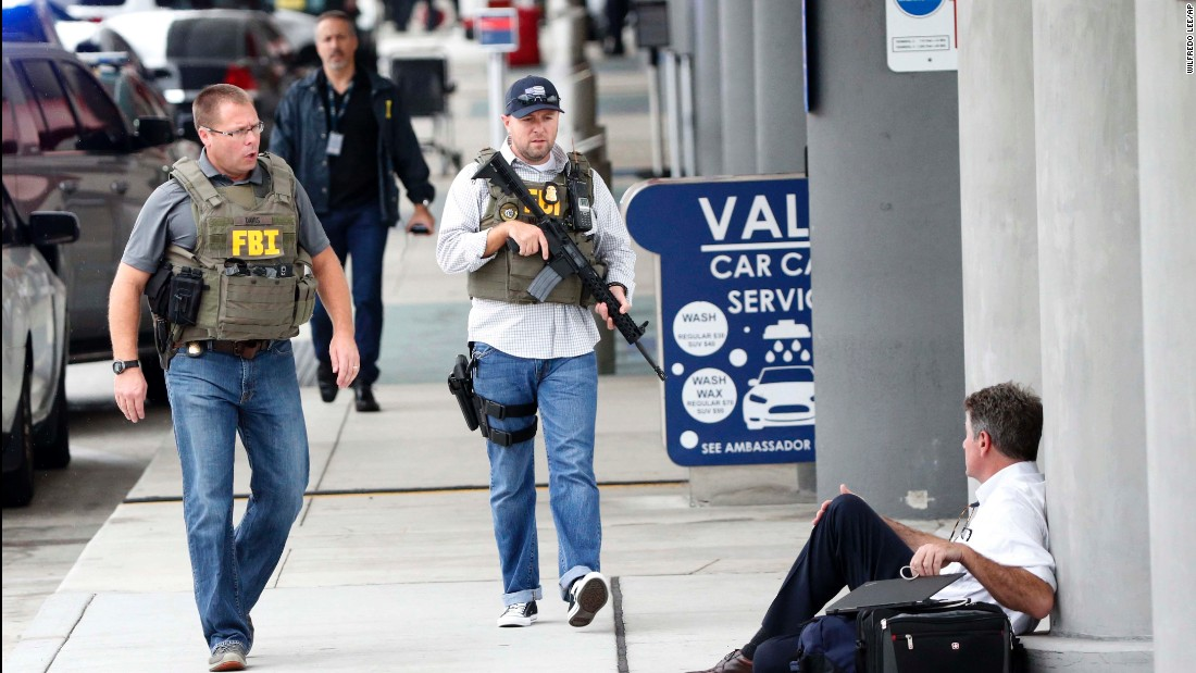 Law enforcement officers arrive at the Fort Lauderdale-Hollywood International Airport.