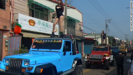 Some 50 pole dancers performed on top of Jeeps during the funeral procession of former Chiayi City county council speaker Tung Hsiang in Chiayi City, southern Taiwan.