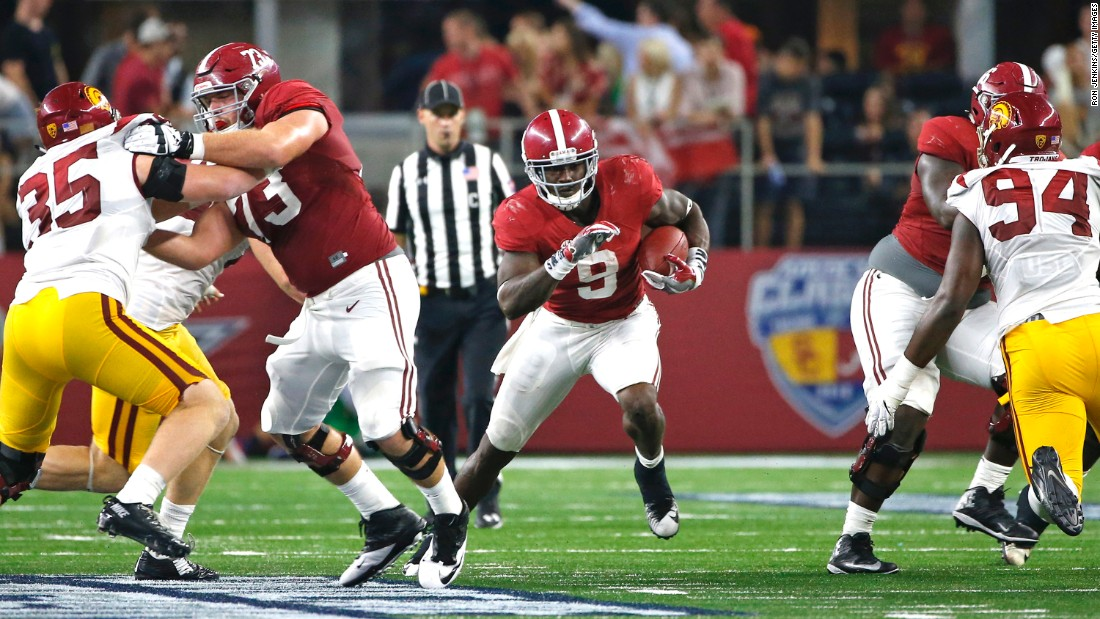 Alabama running back Bo Scarbrough, center, makes his way against the Southern California Trojans in the AdvoCare Classic on September 3 in Arlington, Texas.