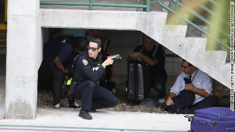 FORT LAUDERDALE, FL - JANUARY 06: First responders assist people seeking cover outside the Fort Lauderdale-Hollywood International airport after a shooting took place near the baggage claim on January 6, 2017 in Fort Lauderdale, Florida. Officials are reporting that five people were killed and eight wounded in an attack by a single gunman.   (Photo by Joe Raedle/Getty Images)
