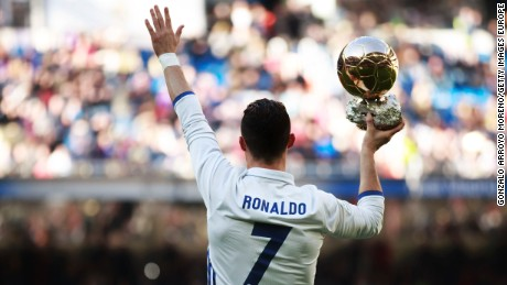 Cristiano Ronaldo shows his fourth Ballon D'Or before Real Madrid beats Granada 5-0 in La Liga.