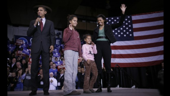 Barack Obama, then a Democratic presidential hopeful, addresses voters at a January 2008 rally in Des Moines, Iowa, accompanied by his wife, Michelle, and daughters Malia and Sasha, then 9 and 6, respectively. Click through the gallery to see how the Obama girls grew up before the nation after their father's 2008 election as President.