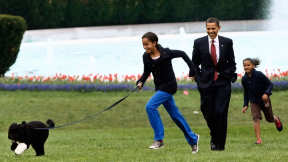 The President takes Malia, left, and Sasha for a walk with their new dog, Bo, on the South Lawn of the White House in April 2009. The Portuguese water dog was a gift from Sen. Edward Kennedy. The first family chose the purebreed puppy largely because of Malia's allergies.