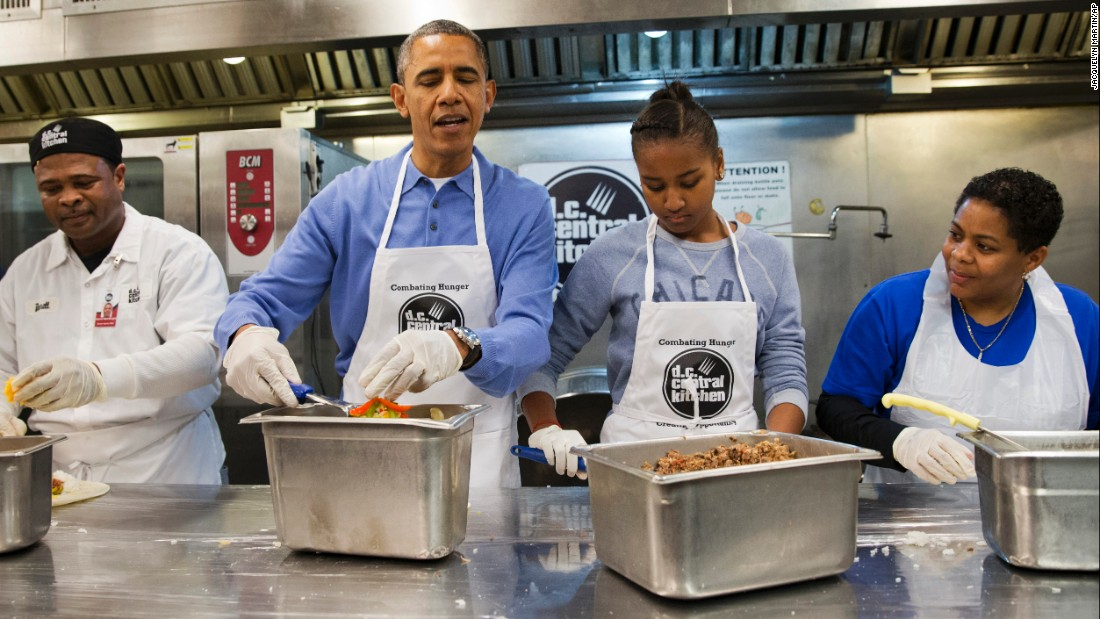 Obama and Sasha make burritos at DC Central Kitchen as part of a service project on Martin Luther King Jr. Day in January 2014.