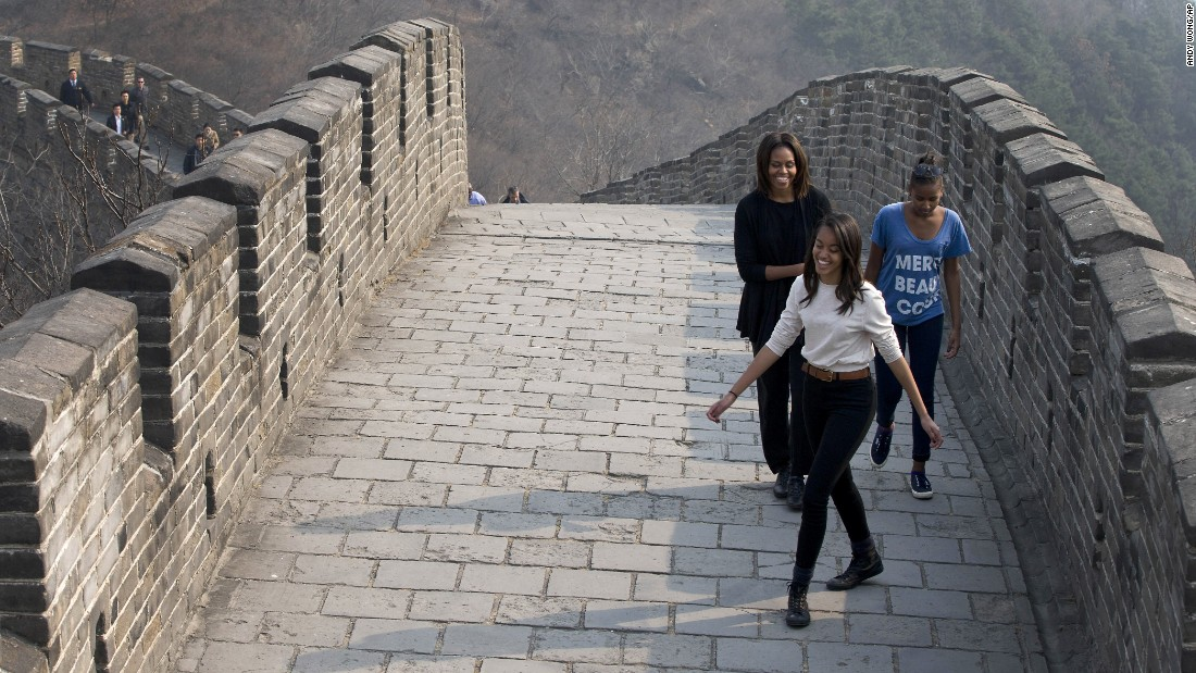 Michelle Obama shares a light moment with her daughters as they visit the Mutianyu section of the Great Wall of China in March 2014.