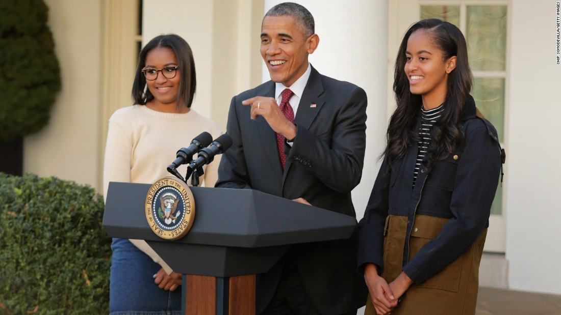 Sasha, left, and Malia join their dad as he delivers remarks for the turkey pardoning ceremony in the Rose Garden at the White House in November 2015.