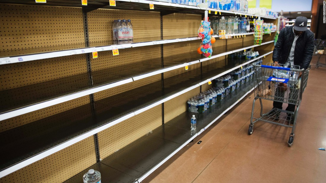 Shelves sit mostly empty at a supermarket in Atlanta on Friday, January 6. Shoppers emptied shelves of bread and milk, road workers began working 12-hour shifts and states of emergency were declared in Alabama, Georgia and the Carolinas ahead of the winter storm.