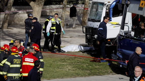 The white truck at right was the one used in the attack.