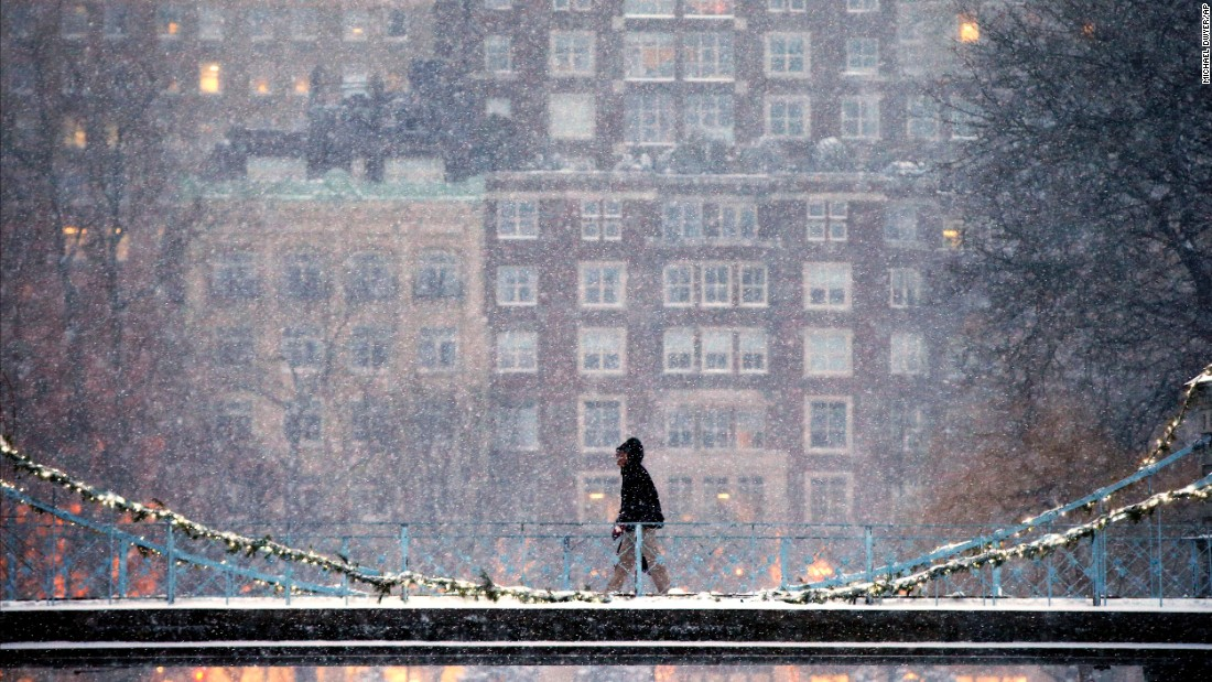 A person crosses the pedestrian bridge in the Public Garden during a winter storm in Boston on January 7.