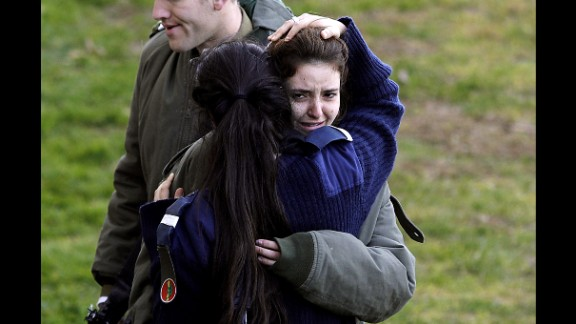 A distraught Israeli soldier is consoled at the site of Sunday's attack.