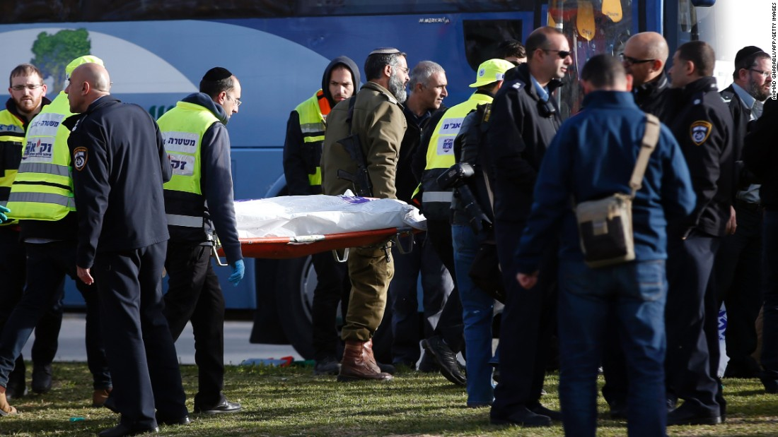 d5c532bfd9 Israeli medics carry a covered body from the scene of the attack.