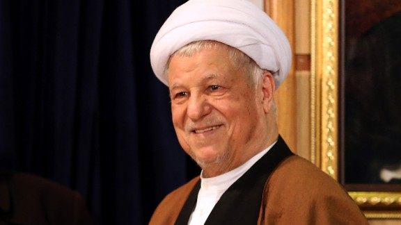 Iranian former president and head of the Expediency Council, Akbar Hashemi Rafsanjani arrives for a press conference after registering his candidacy for the upcoming Assembly of Experts elections at the interior ministry in Tehran on December 21, 2015. The 86-member Assembly's role is to monitor the work of the supreme leader, currently Ayatollah Ali Khamenei (portrayed in the background). The poll will coincide in February 2016 with parliamentary elections, which could see more moderates and reformists chosen on the back of Iran's recent nuclear deal with world powers. AFP PHOTO / ATTA KENARE / AFP / ATTA KENARE        (Photo credit should read ATTA KENARE/AFP/Getty Images)