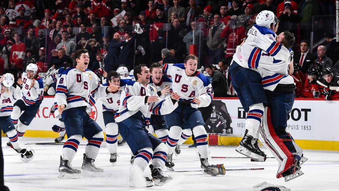 American hockey players rush to goalie Tyler Parsons after winning the World Junior Championship on Thursday, January 5. The United States defeated Canada in a shootout.