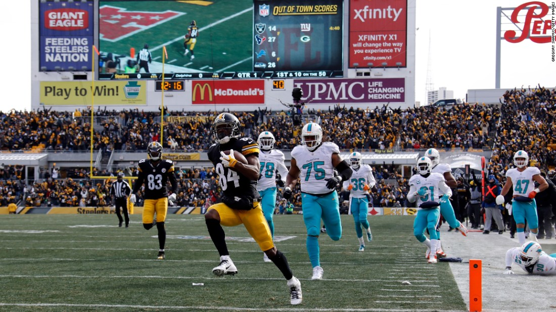 Pittsburgh wide receiver Antonio Brown scores the opening touchdown in the Steelers' playoff win over Miami on Sunday, January 8. Brown had two touchdowns and 124 receiving yards in the 30-12 victory.