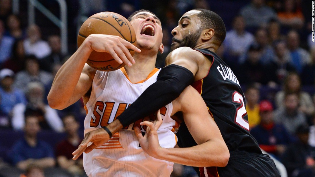 Phoenix guard Devin Booker is fouled by Miami's Wayne Ellington during an NBA game in Phoenix on Tuesday, January 3.