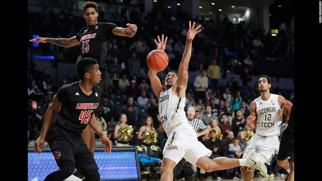 Georgia Tech's Tadric Jackson has the ball knocked away by Louisville' Ray Spalding, top left, during a game in Atlanta on Saturday, January 7.