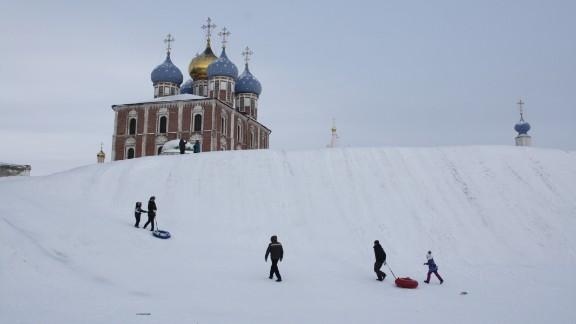 Children near the Ryazan Kremlin brave the cold to go sledding