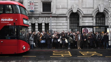 Commuters line up for buses in central London on Monday during a 24-hour Tube strike.