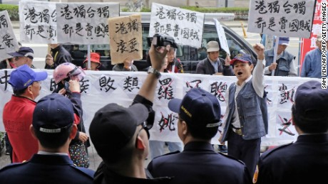 "Pro-China protesters waving placards reading ""independence will get you nowhere"" greeted Hong Kong pro-democracy activist Joshua Wong and other lawmakers in Taipei."