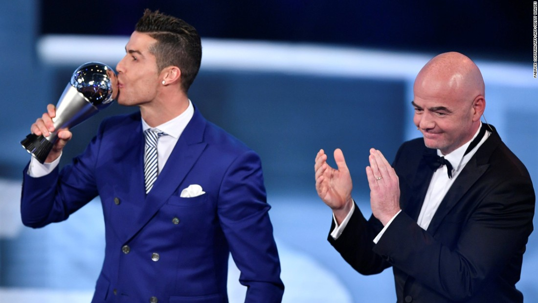 The Real Madrid and Portugal forward accepted his award from FIFA president Gianni Infantino after beating Lionel Messi and Antoine Griezmann in the vote.