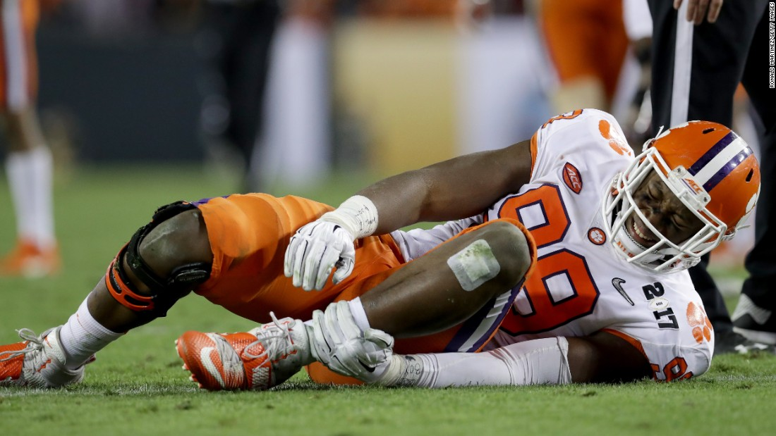 Clemson defensive end Clelin Ferrell holds his ankle after spraining it in the third quarter. He was unable to return to the game.