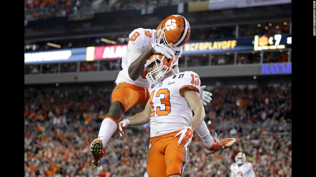 Clemson wide receiver Deon Cain, left, celebrates with Renfrow after Renfrow's 24-yard touchdown catch in the third quarter. Clemson cut the Alabama lead to 17-14.