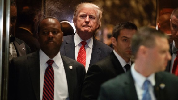 Trump gets on an elevator after speaking with reporters at New York