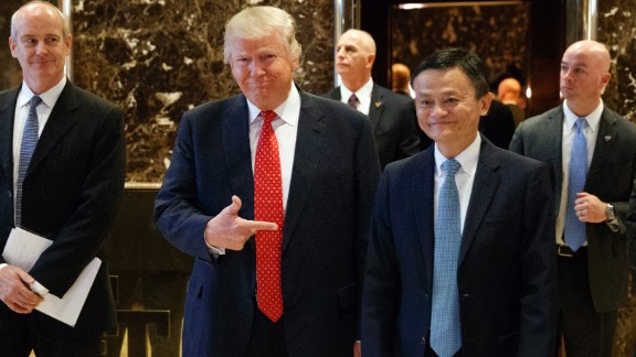 "Trump stands with Alibaba Executive Chairman Jack Ma, Asia's richest man, as they walk to speak with reporters at Trump Tower on January 9. Ma met with Trump to tease plans for creating ""one million"" jobs in the United States. Trump praised Ma after the meeting as a ""great, great entrepreneur and one of the best in the world."""