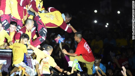 Traslacion participants jostle through the crowds as they try to touch and kiss the Black Nazarene on Monday, July 9.