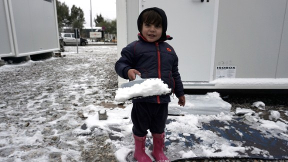 A child plays in the snow at the Kara Tepe camp on the island of Lesbos following heavy snowfalls.