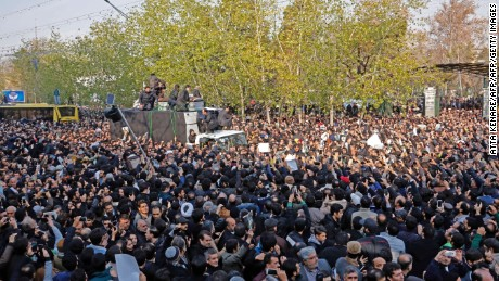 Iranians surround a hearse carrying the coffin of former President Akbar Hashemi Rafsanjani in Tehran on January 10, 2017.