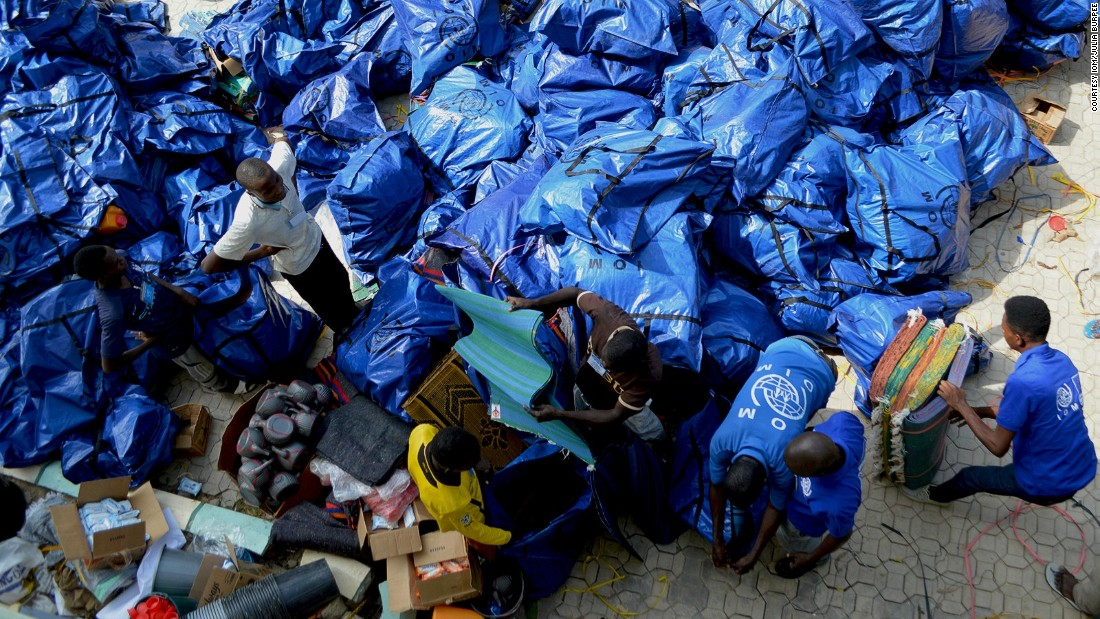 After food, household items are in highest demand. Pictured here, IOM staff pack aid parcels to be delivered to displaced families across the northeast. Over the last year their kits have reached 160,000 people, according to the organization.
