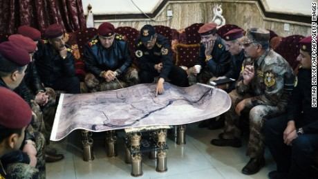 Staff General Taleb Shegati al-Kenani (C), top commander of the Counter-Terrorism Service, studies a map with his team of officers in Mosul's Al-Zahraa neighbourhood on January 7, 2017.