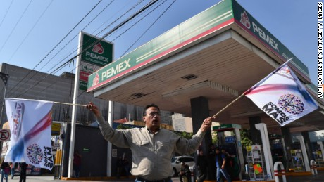 Activists shout slogans against the rise in fuel prices while blocking a gas station along Tlalpan avenue during a protest in Mexico City on January 3, 2017.  Mexicans angry over a steep hike in gasoline prices blocked roads around the country Monday, but the government refused to budge on the energy reform behind the increase. / AFP / YURI CORTEZ        (Photo credit should read YURI CORTEZ/AFP/Getty Images)