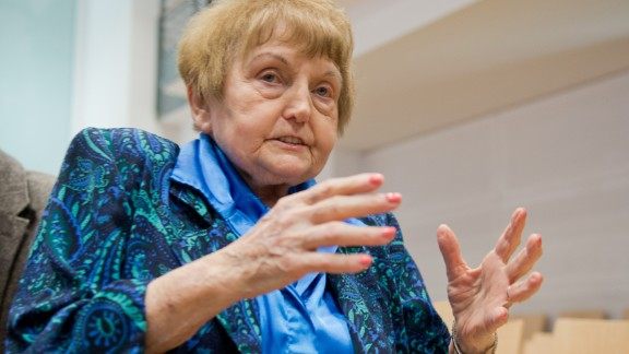 "Auschwitz survivor and plaintiff Eva Kor attends the trial of former Nazi death camp officer Oskar Groening on April 21, 2015 in Lueneburg, northern Germany. The 93-year-old man dubbed the ""bookkeeper of Auschwitz"" is being tried on ""accessory to murder"" charges in 300,000 cases of deported Hungarian Jews who were sent to the gas chambers, and faces up to 15 years jail.    AFP PHOTO / POOL / JULIAN STRATENSCHULTE        (Photo credit should read JULIAN STRATENSCHULTE/AFP/Getty Images)"