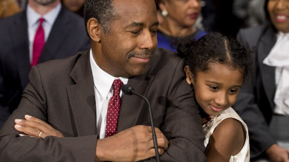 "Carson greets Tesora prior to testifying before the Senate Committee of Banking, Housing and Urban Affairs in January. In his opening statement, he noted that he was raised by a single mother who had a ""third-grade education"" and made the case that he understands the issues facing the millions of people who rely on HUD programs."