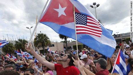 TOPSHOT - Cuban Americans in Miami's Little Havana celebrate the death of longtime Cuban leader Fidel Castro on November 26, 2016.  Cuba's socialist icon and father of his country's revolution Fidel Castro died on November 25 aged 90, after defying the US during a half-century of ironclad rule and surviving the eclipse of global communism. / AFP / RHONA WISE        (Photo credit should read RHONA WISE/AFP/Getty Images)