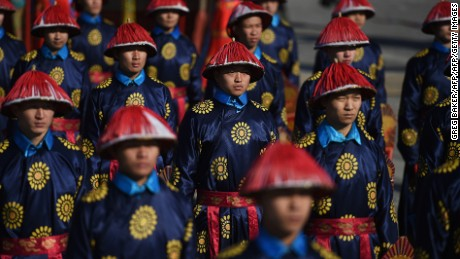Performers dressed as imperial guards take part in a rehearsal of a sacrifice ceremony at the Altar of the Earth  in Ditan park in Beijing on February 6, 2016. The ceremony is a re-enactment of sacrifices once made by China's emperors to the God of the Earth to guarantee good harvests in the new year, and will be stage on February 8 to mark the beginning of the Lunar New Year. AFP PHOTO / GREG BAKER / AFP / GREG BAKER        (Photo credit should read GREG BAKER/AFP/Getty Images)