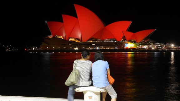 Around the city, Sydney: The city's iconic Sydney Opera House gets a red hue in honor of Lunar New Year.