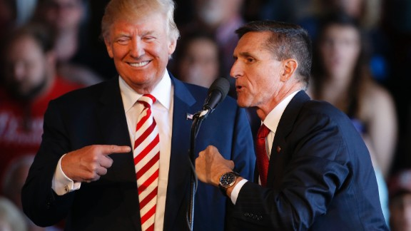 GRAND JUNCTION, CO - OCTOBER 18: Republican presidential candidate Donald Trump (L) jokes with retired Gen. Michael Flynn as they speak at a rally at Grand Junction Regional Airport on October 18, 2016 in Grand Junction Colorado. Trump is on his way to Las Vegas for the third and final presidential debate against Democratic rival Hillary Clinton. (Photo by George Frey/Getty Images)
