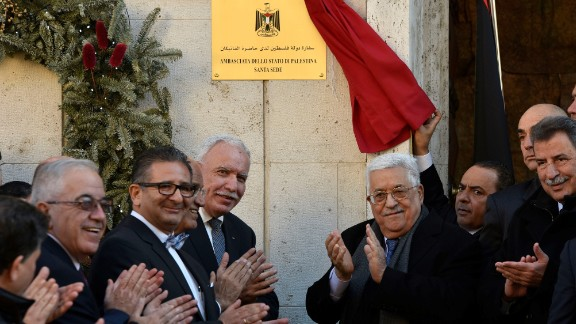 Palestinian President Mahmoud Abbas applauds the opening of the Palestinian Embassy in Vatican City.