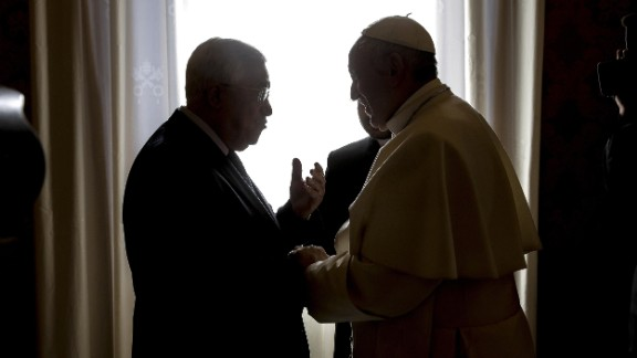 Pope Francis, right, meets with Palestinian President Mahmoud Abbas during a private audience at the Vatican.