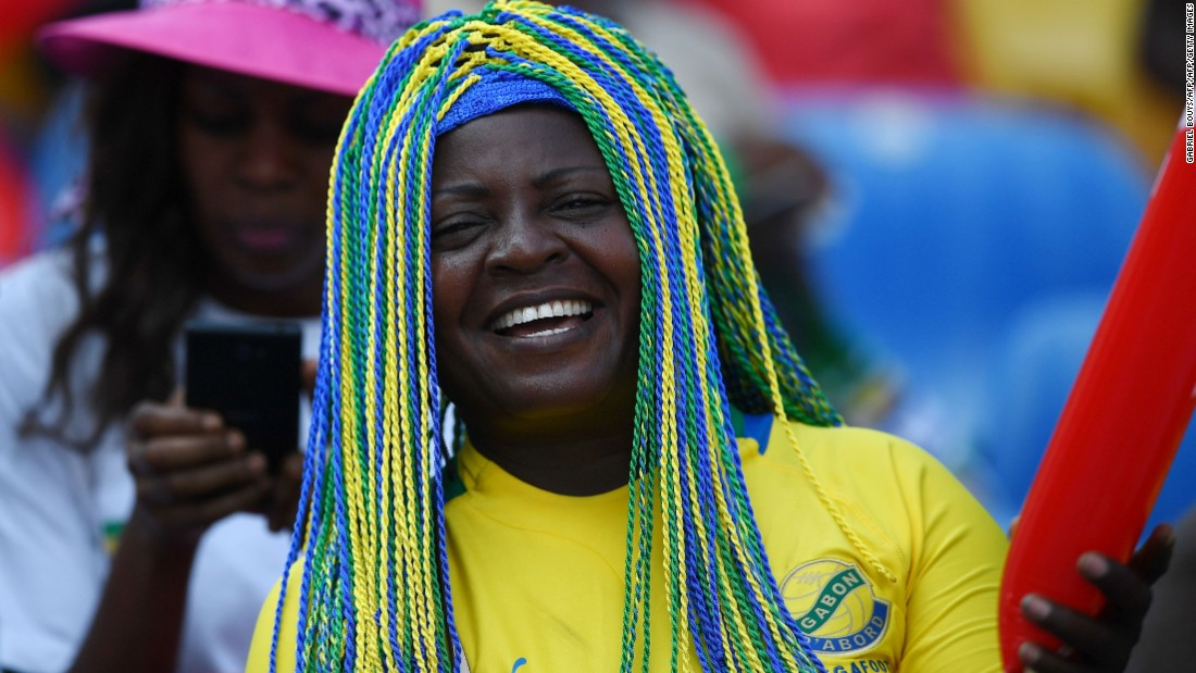 A Gabon supporter cheers before the home nation met tournament debutant Guinea-Bissau at the Stade de l'Amitie Sino-Gabonaise.