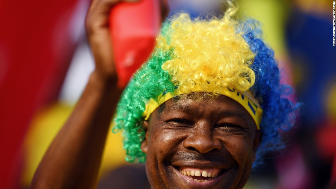 Another supporter of host nation Gabon wears a wig displaying national colors.